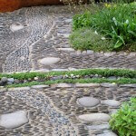 J & S Scapes - Rill running through pathway