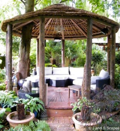 9-bespoke-outdoor-room-made-from-eucalyptus-poles-thatch-roof-and-ipe-decking-j-and-s-scapes