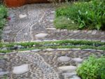j-s-scapes-rill-running-through-pathway